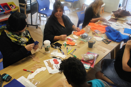 Women at the YWCA Toronto Elm Centre making Faceless Dolls