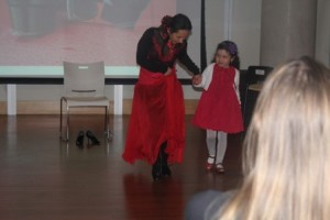 Elizabeth Meneses di Castillo dancing with her daughter in her first pair of flamenco shoes